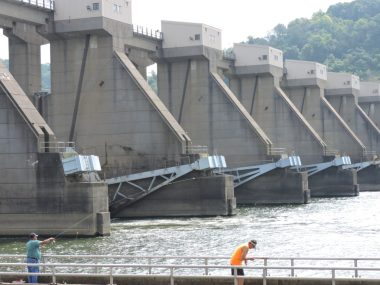 The Ohio side of the Pike Island Locks and Dam is a popular summer fishing spot. Photo by Casey Junkins.