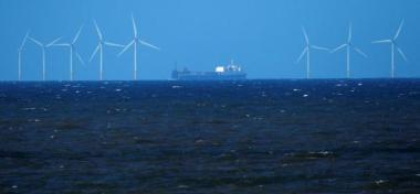 A ship sails past the 90-MW Barrow offshore wind farm. Reuters / David Moir