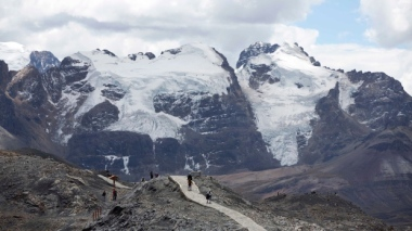 Tourists walk near the Tuco glacier in Peru. (AP / Martin Mejia)