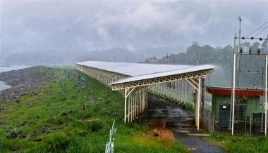 Solar panels erected atop the Banasura Sagar Dam at Padinharethara in Wayanad district.