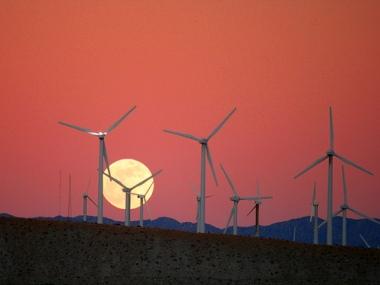 "Moonrise at a wind farm. Image Credit: Flickr via ""Caveman Chuck"" Coker"