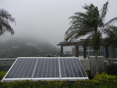 Solar panels in Hong Kong. Photo by Snowacinesy. CC BY-SA 3.0. Wikimedia Commons.