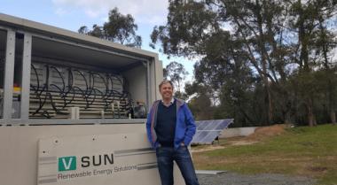 AVL managing director, Vincent Algar, next to the CellCube vanadium redox flow battery.