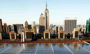 Solar panels on a Rockefeller Center rooftop in midtown Manhattan in New York. (Photograph: Mark Lennihan / AP)