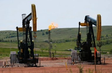 Oil pumps and natural gas flaring  (Photo credit: Associated Press / The Wall Street Journal)