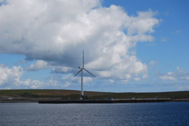 Wind turbine, on Sanday, in the Orkney Islands (Photo by hayley green, CC BY-SA, Wikimedia Commons)