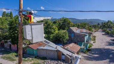Electric work in Môle-Saint-Nicolas, Haiti