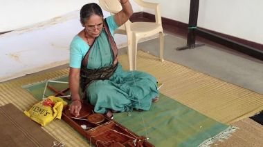Lady spinning yarn in a Charkha in Bangalore