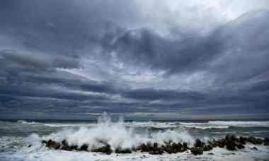 Typhoon waves breaking on anti-tsunami barriers near  Fukushima Daiichi (Photograph: Damir Sagolj/Reuters)