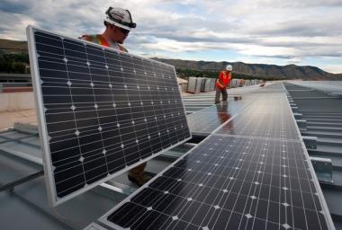 Installing solar panels (Wikimedia Commons)