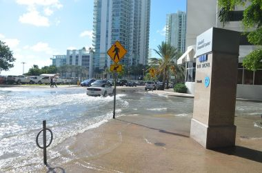 Sunny day flooding now hits Miami regularly, thanks to rising sea levels. (Photo by B137, CC BY SA, Wikimedia Commons)
