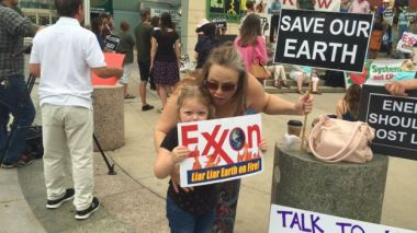 Protestors young and old making their feelings heard at the Exxon Mobil annual general meeting in Texas