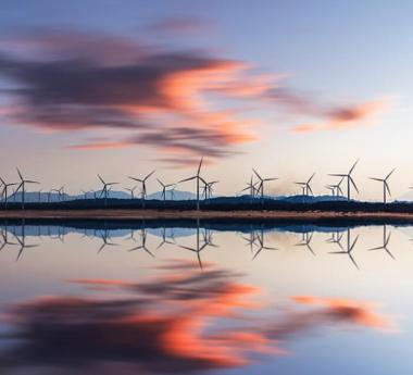 Wind turbines reflected on the water